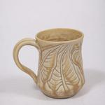 This mug has an incised pattern. I make several different styles of mugs and the prices range from $16.00 to $24.00.