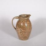 This pitcher has a wax resist pattern. It sells for $60.00.